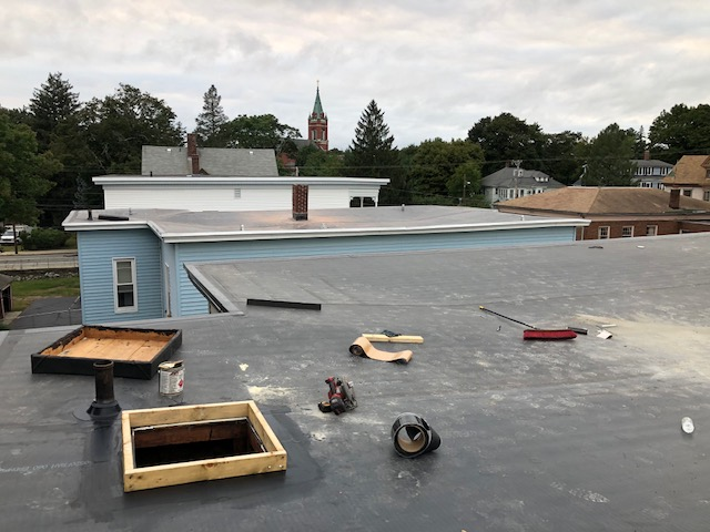 Two recently completed flat-roof replacements in Woonsocket, RI